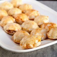Miniature apple pie puffs served with warm caramel sauce.