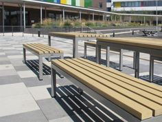 Parallel PPB 6 benches and PPT 6 tables, both with wood plastic composite slats Garden Seating, Outdoor Seating, Outdoor Dining, Outdoor Decor, Timber Slats, Timber Wood, Contemporary Outdoor Benches, Street Furniture, Building Design