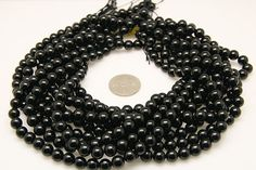 1strand  natural black tourmaline plain ball sized 8mm by 3yes