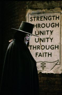 """V for Vendetta,"" 2006 Costume design: Sammy Sheldon black wool felt hat with grosgrain ribbon band and long black wool cape - worn by Hugo Weaving in the role of V V For Vendetta 2005, V Pour Vendetta, V For Vendetta Poster, V For Vendetta Quotes, Vendetta Mask, Film V, Film Serie, Pulp Fiction, Science Fiction"