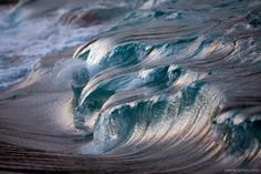 Some *spectacular* photographs of waves by Pierre Carreau. These look more like sculptures than giant crashing waves. Many more at the link:  http://www.thisiscolossal.com/2013/05/liquid-sculptures-powerful-waves-photographed-by-pierre-carreau-seem-frozen-in-time