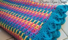 This Free Crochet Pattern is an adorable baby blanket that is bright and cheery... It can be made using one or more colors to get the effect you desire. Great