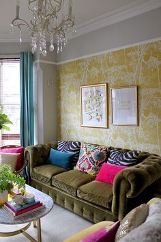 Colourful eclectic living room with olive green velvet sofa: