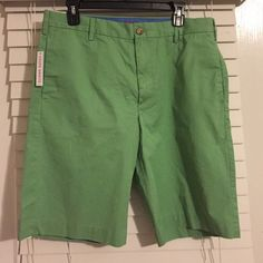 "Izod green shorts size 33"" waist New with tags, light green, 11"" inseam. 100% cotton. Machine wash IZOD Shorts"