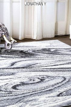 Mingled threads of charcoal and ivory create a modern, abstract black and white design on your floor. This durable rug's swirling marble pattern makes it perfect for homes with kids and pets. It's the perfect centerpiece for a mid-century modern, contemporary, or even a minimalist interior. Contemporary Rugs, Modern Rugs, Mid-century Modern, Office Set, Build Your Dream Home, Marble Pattern, Black And White Design, Minimalist Interior, Home Rugs
