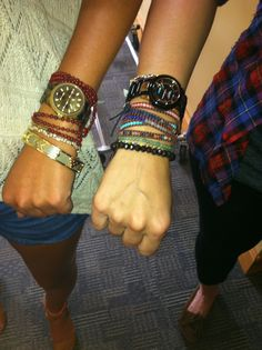 love how the watches are layered with the bracelets!