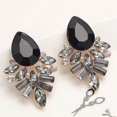 Black and Silver Jeweled Earrings Brand new adorable black and silver fashion earrings. Perfect condition. Jewelry Earrings