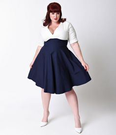 Let Delores get domestic with you, darling. A bewitching navy skirt and white top plus size dress rich in 1950s vintage appeal fresh from Unique Vintage, Delores is unparalleled! Boasting a gathered surplice v-neckline, trim and tailored half sleeves with