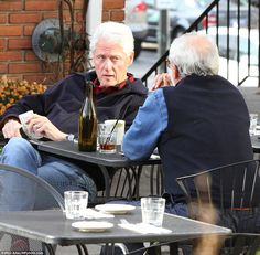 Bill Clinton was spotted relaxing at lunch with a friend and taking selfies with fans - days after his wife lost the presidency