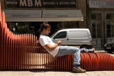 Worm-Like Sculpture Attaches Itself to Portuguese Bus Stop ...