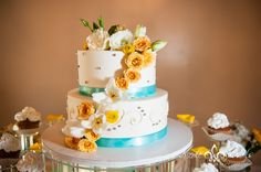 teal and yellow wedding  cake at Denver wedding