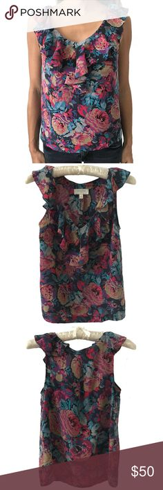 Anthropologie Moulinette Soeurs Silk Ruffle Top Gorgeous 100% Silk floral ruffle top by Moulinette Soeurs, sold at Anthropologie. This is absolutely the perfect sleeveless top for Spring! A beautiful blend of color. Actual product shown in all photos.  Label says Size 0, but would fit a size 0 or 2.  17 inches from pit to pit, 23 inches in length. Moulinette Soeurs Tops