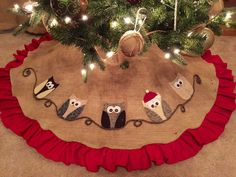 For all the owl fans out there, this is a must have under your tree!! 5 owls perched perfectly amongst burlap, ruffles and yarn. One is even in the spirit with his little santa hat on! Details: The ow