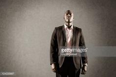 Stock Photo : African American man in suit looking satisfied