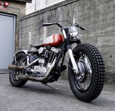 Despite the Husqvarna tank and retro graphics, this is a Harley-Davidson Sportster customized by the Danish workshop Wrenchmonkees.