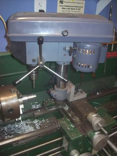 Drill Press Adaptor by RobbieKnobbie -- A homemade adaptor for mounting a drill press on a lathe. A T-slot is fixed underneath the angle plate. Knuckle is modified to accept 5/8-11 bolts. http://www.homemadetools.net/homemade-drill-press-adaptor