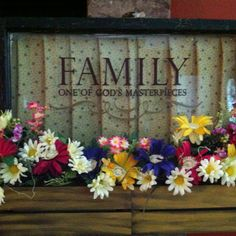 Repurposed this old window I found  at a barn sale and donated it for a family reunion raffle item this summer. Sanded, painted, and added wooden flower boxes filled with an arrangement of spring flowers. Topped it all off with a great family quote.