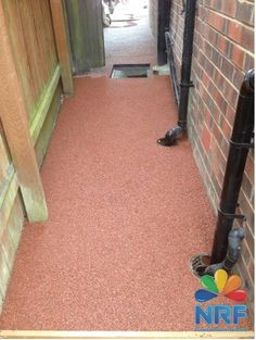 Complete installed new red driveway by Northern Resin Flooring Ltd with Logo.