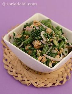 A salad that is nutty enough to leave you asking for more. The combination of walnuts with a tangy dressing and bland spinach leaves is quite a creation to try out.