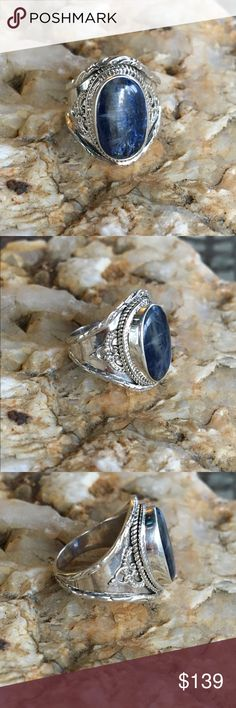 Kyanite artisan made solid sterling silver ring Gorgeous large oval cabochon of genuine kyanite set in an intricately detailed artisan made solid sterling silver ring. Variations in natural stone and artisan handcrafted work make this ring one of a kind. Jewelry Rings