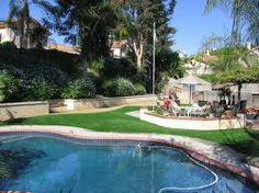 Amazing use of synthetic Grass around pools!! Synthetic Turf Depot 866-655-3040