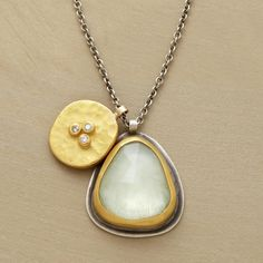 SANTORINI NECKLACE--In this Ananda Khalsa aquamarine and diamond pendant necklace, the rose-cut aquamarine reflects the sea