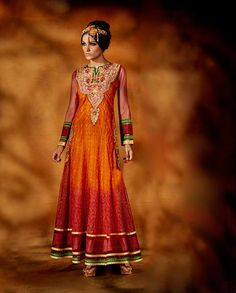 Orange And Maroon Anarkali Suit with embroidered neckline   1. Drafted in the fabric of net, tissue and dupion this orange and maroon anarkali Suit is sure to add a spark. The kameez is designed and embroidered in ari work on the kalis which is added with colorful zari and embroidery on front and back neckline . 2. Comes with matching bottom and dupatta3. Sizes avaialble: M, L, XL, XXL