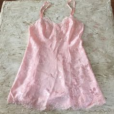 Victoria's Secret Peach Nightgown. Size Medium Victoria's Secret Brocade Peach Nightgown. Size Medium. NWOT condition. 100% polyester with beautiful lace trim detail. Victoria's Secret Intimates & Sleepwear Chemises & Slips