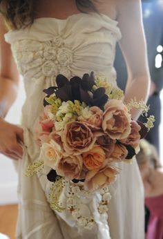 Love the dress, love the roses and those dark leaves or flowers. Just completely beautiful.