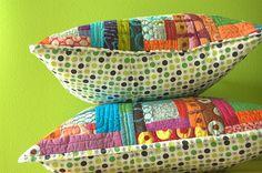 Pillow stack by stitchindye, via Flickr