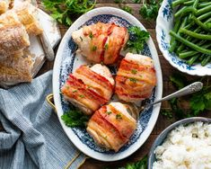 This 4-ingredient Bacon Wrapped Chicken Breast is a delicious dinner that's simple enough for weeknight meals, but also fancy enough for entertaining. Each chicken breast is stuffed with chive and onion cream cheese, wrapped with slices of bacon, and baked in the oven until crispy on the outside and juicy on the inside. Serve the perfect little bundles with rice, crusty bread, green beans or salad! Busy moms can always use new and flavorful chicken breast recipes, and this stuffed bacon…