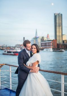 Louise and Phil's London city wedding just oozed style! An industrial chic reception venue on the Thames made the most stunning backdrop for this couple's wedding photographs!
