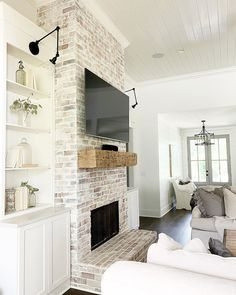Take your home's fireplaces into the next level by designing an indoor fireplace makeover. What you need is a personalized fireplace design for your home. It is the perfect way to give your home a new, streamlined look. Farmhouse Fireplace, Home Fireplace, Fireplace Remodel, Living Room With Fireplace, Fireplace Design, Fireplace Ideas, White Wash Brick Fireplace, Fireplace With Built Ins, Brick Fireplace Makeover