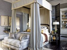 Hubert Zandberg designed this townhouse and the four-poster bed in the master suite; the room's sofa is by Jansen, and the silver-leafed-bronze table lamps are by Hervé Van der Straeten from Alexandre Biaggi.