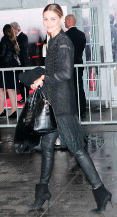 Olivia Palermo in black leather pants, booties and a fringe top