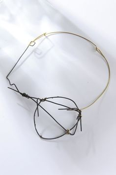 Roxy Lentz – Necklace – Steel wire, brass