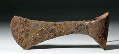Northern Europe, ca. 1000 CE. This is a large, heavy socketed iron battle axe that is almost certainly made of bog iron, iron that forms naturally in bogs after being washed by streams from nearby mountains. This was the primary source of iron for the Vikings, and some scholars have even argued that the need for more iron from bogs drove Viking expansion. Iron arms and armor in the Viking world were treasured objects that were frequently passed down from generation to generation; this axe…