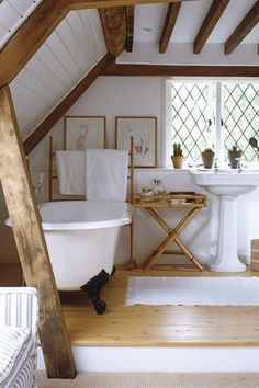 Cottage Full Bathroom with Restoration hardware park pedestal sink, Pedestal sink, Exposed beam, Clawfoot, Hardwood floors