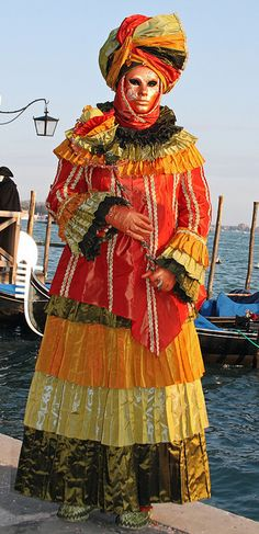 Colorful costumes and masks at the 2010 Carnevale in Venice (IMG_9128a), via Flickr.