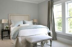 bedrooms - blue bedding blue gray walls paint color bench mirrored lamps espresso nightstands blue gray silk drapes nailhead trim headboard