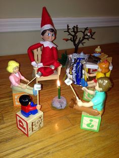 Elf on the shelf, cute idea: Roasting marshmallows over a birthday candle with the doll house family and Duplo people! Don't forget the chocolate and graham crackers!!!! Of course, blow the candle out after you've blackened some mallows :) elv