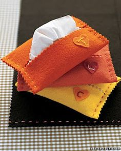 Make a pretty felt cover for carrying a pack of necessary tissues in a purse or diaper bag!