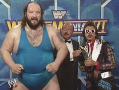 WWF / WWE: Wrestlemania 6 - Earthquake (w/ Jimmy Hart) speaks to Mean Gene Okerlund about his upcoming match against Hercules. I find it funny that each time I see him, he is sweating, which is normal for a big man, but he is also jumping around. Wwf Superstars, Wrestling Superstars, Wrestling Wwe, Old Warrior, Upcoming Matches, Wwe Tna, Wwe Wallpapers, Professional Wrestling