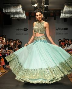 "pehchaanfashion: "" Karisma Kapoor looking stunning in a showstopping sky blue and gold lehenga at Lakme Fashion Week 2014 """