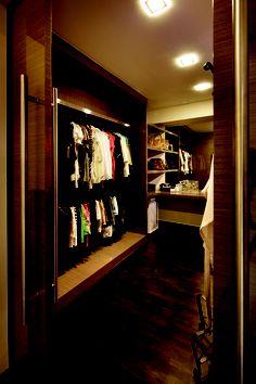 Walk-in wardrobe design looks cozy and inviting.