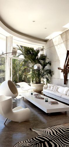 Cool modern living room! I hate animal print, so that rug would have to go!