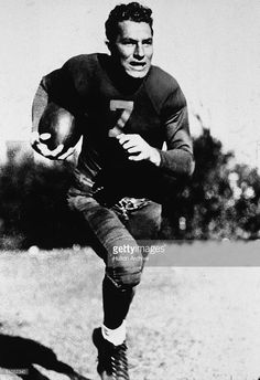 American football player Don Hutson (1913 - 1997) runs with a ball, 1940s. Hutson played in 11 seasons with the Green Bay Packers, and retired with more than 18 league records.
