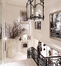 A grand marble staircase ribbons its way through the building's four floors.