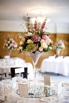 the Fine Flower Company at Pennyhill-Park. I've never cared for martini glass vases until I saw them used here.