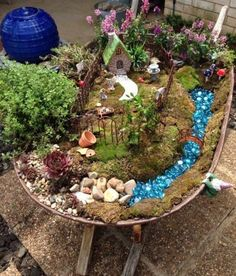 If you're looking for the best collection of Wheelbarrow Fairy Garden Ideas we have lots of great ideas including the wheelbarrow fairy garden BHG.